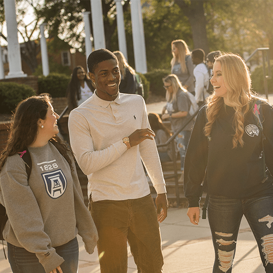Students walking at the Summerville Campus on a fall day