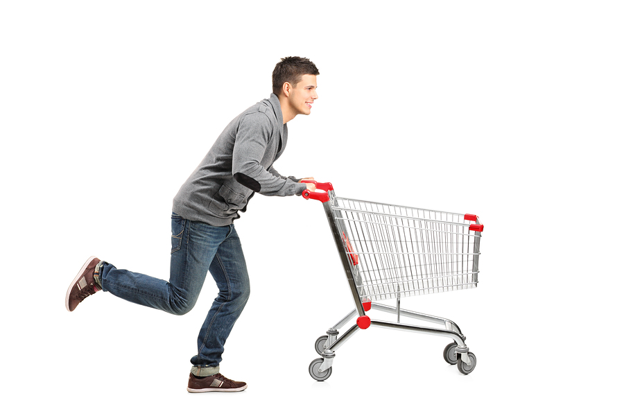 Man running behind a shopping cart