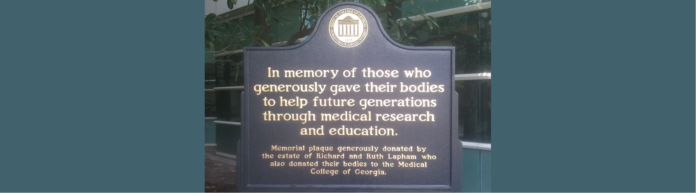 "Plaque with MCG logo that reads: ""In memory of those who generously gave their bodies to help future generations through medical research and education. Memorial plaque generously onated by the estate of Richard and Ruth Lapham who also donated their bodies to the Medical College of Georgia."""