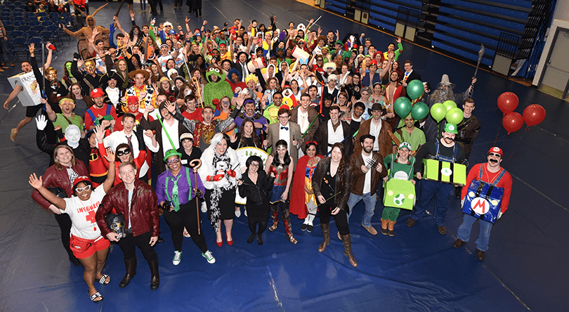 Group of people in costumes posing for photo