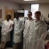 summer students in lab coats