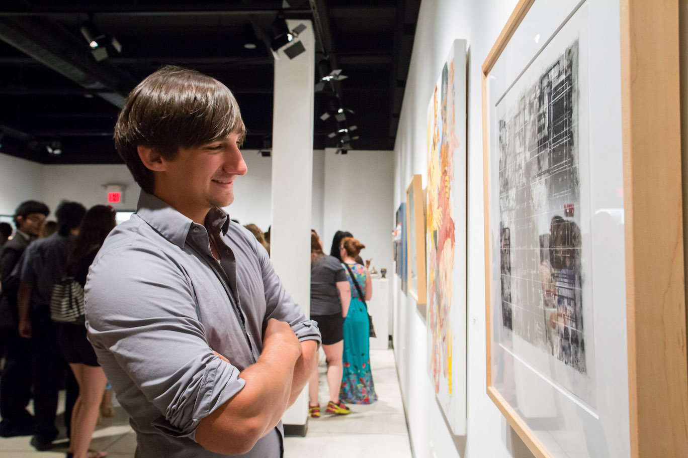 A student admires artwork featured in the Mary S. Byrd Gallery at Augusta University