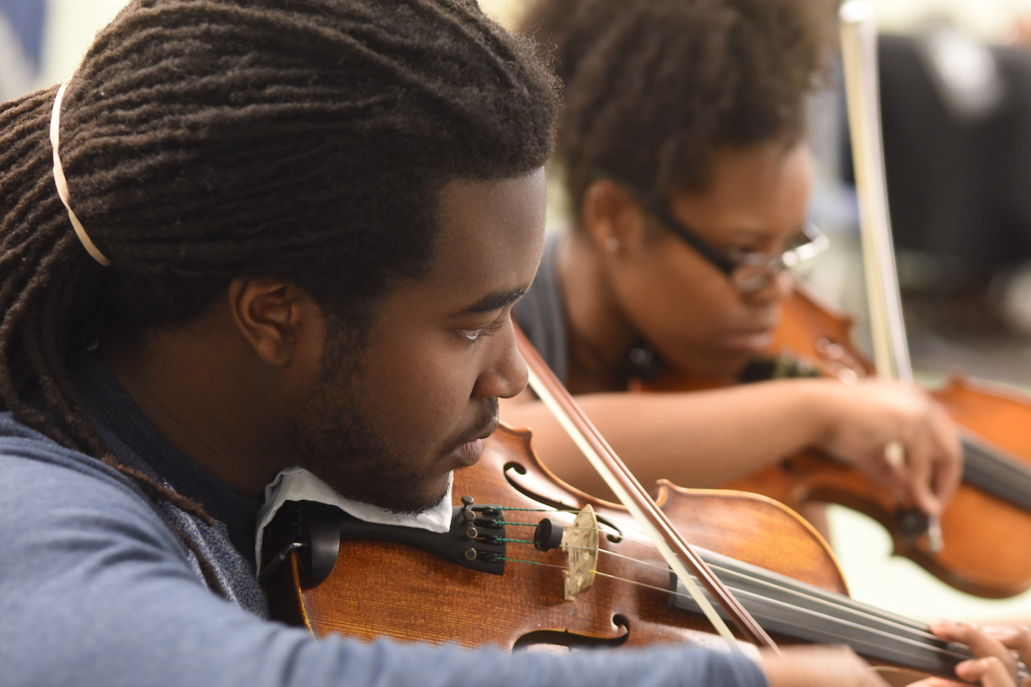 Students playing violins within the music program at Augusta University