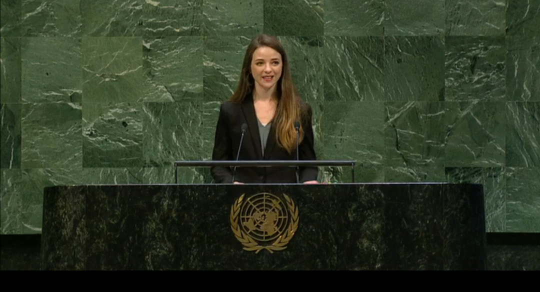 Beth Zinkhan giving a speech at the UN Headquarters