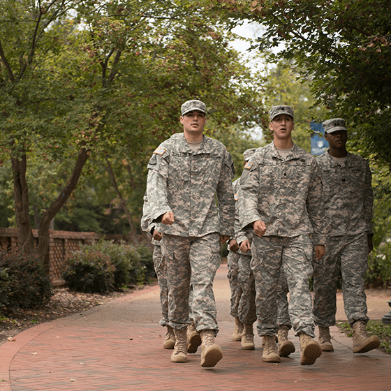 Military walking on campus