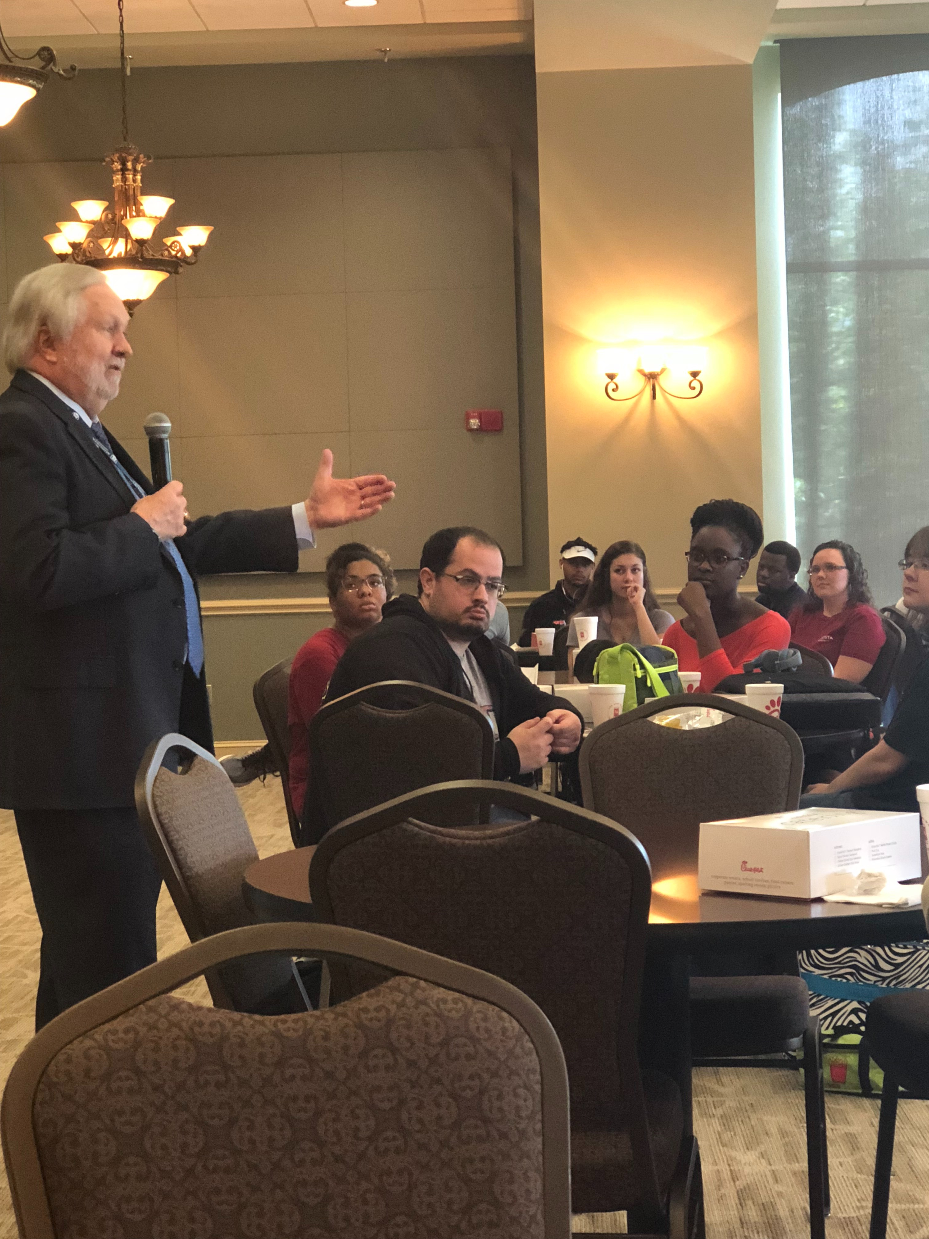 Dr. Brooks Keel talking to students